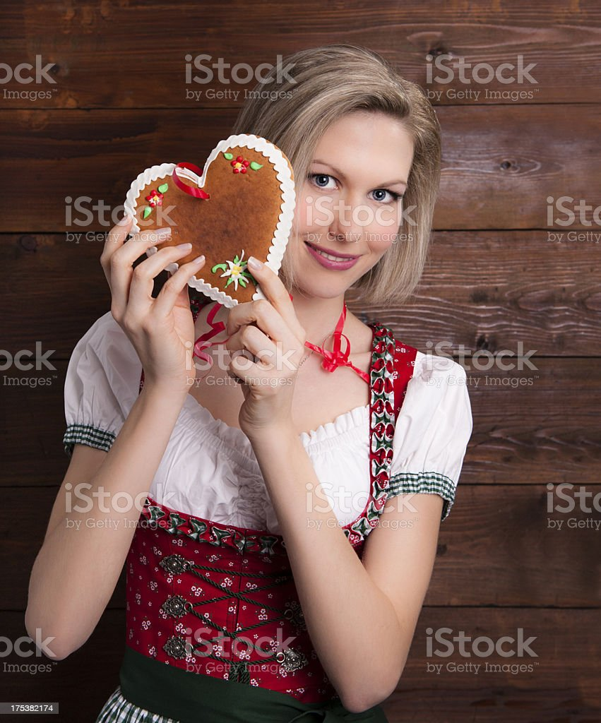 Smiling girl with gingerbread heart royalty-free stock photo