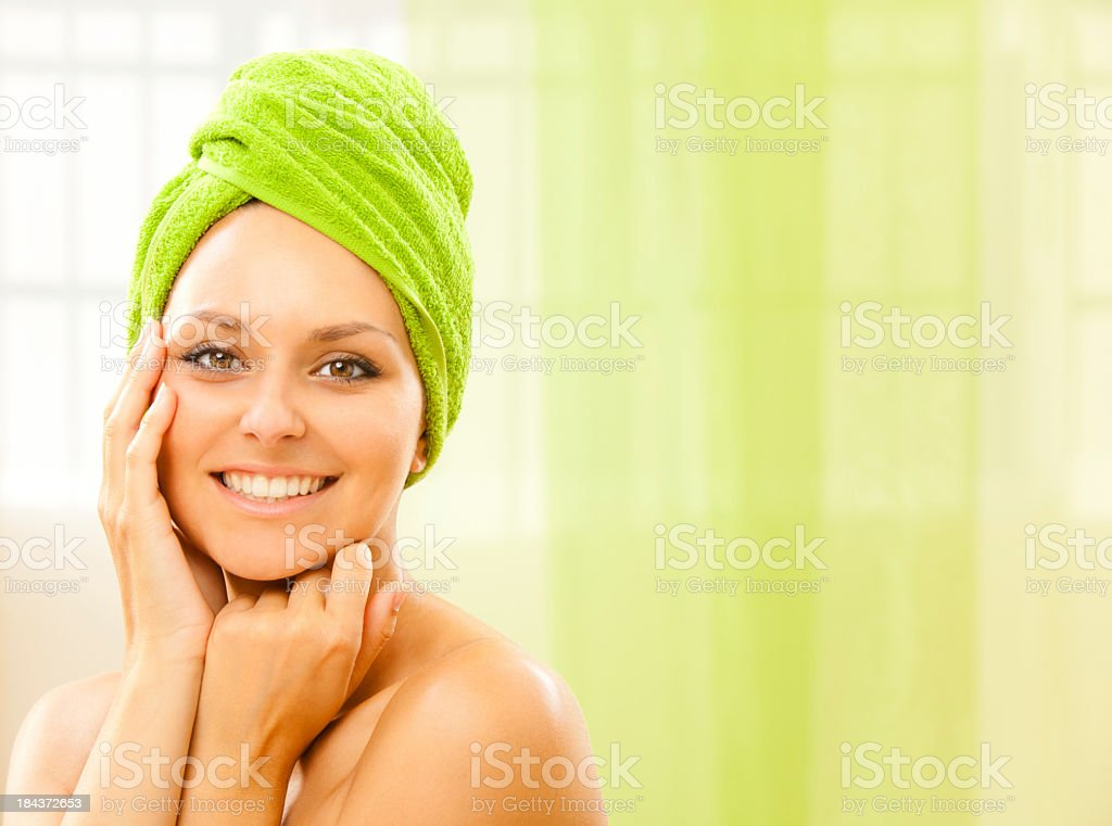 Smiling girl with green towel on head at a health spa royalty-free stock photo