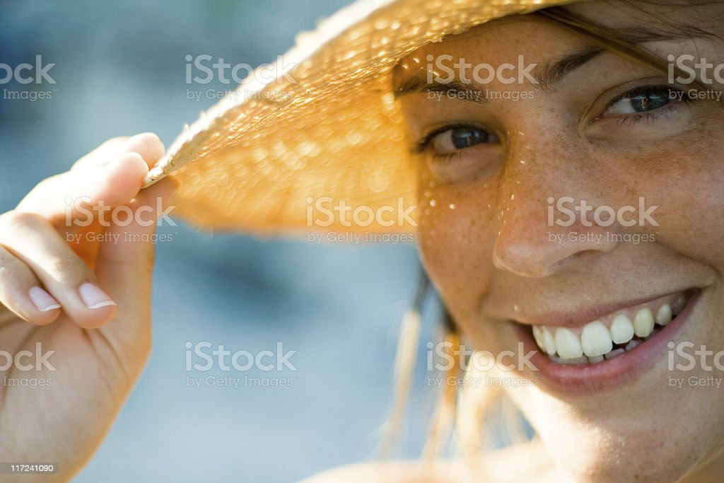 smiling girl with hat stock photo