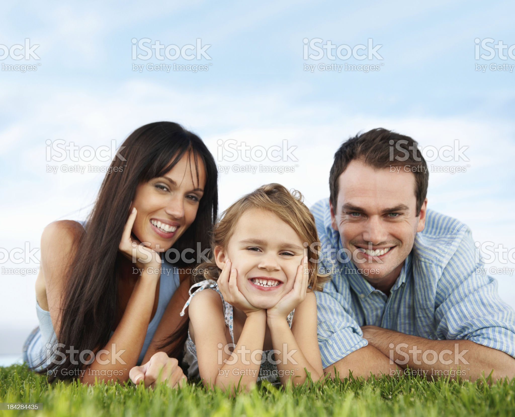 Smiling girl with her parents royalty-free stock photo