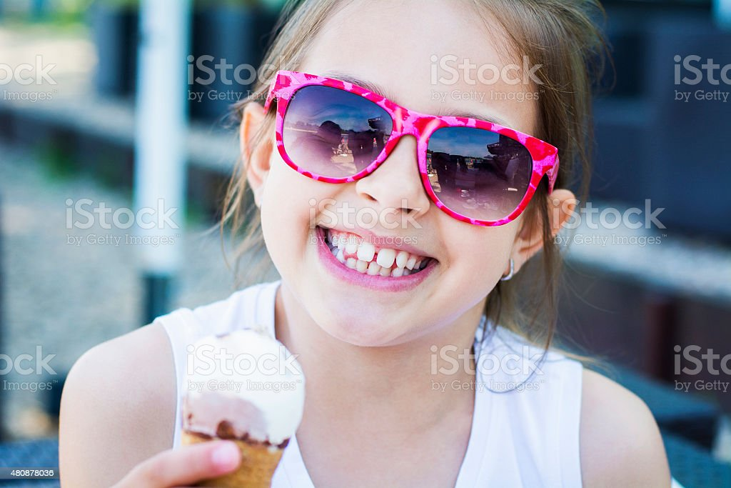 Smiling girl with ice cream stock photo