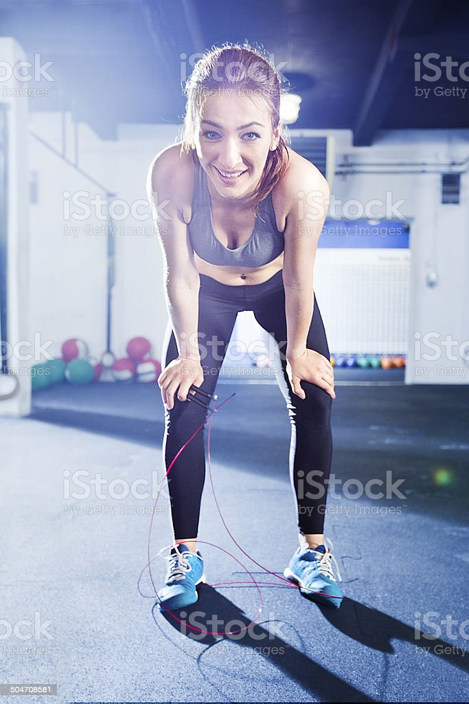 Smiling girl with Jumping rope stock photo