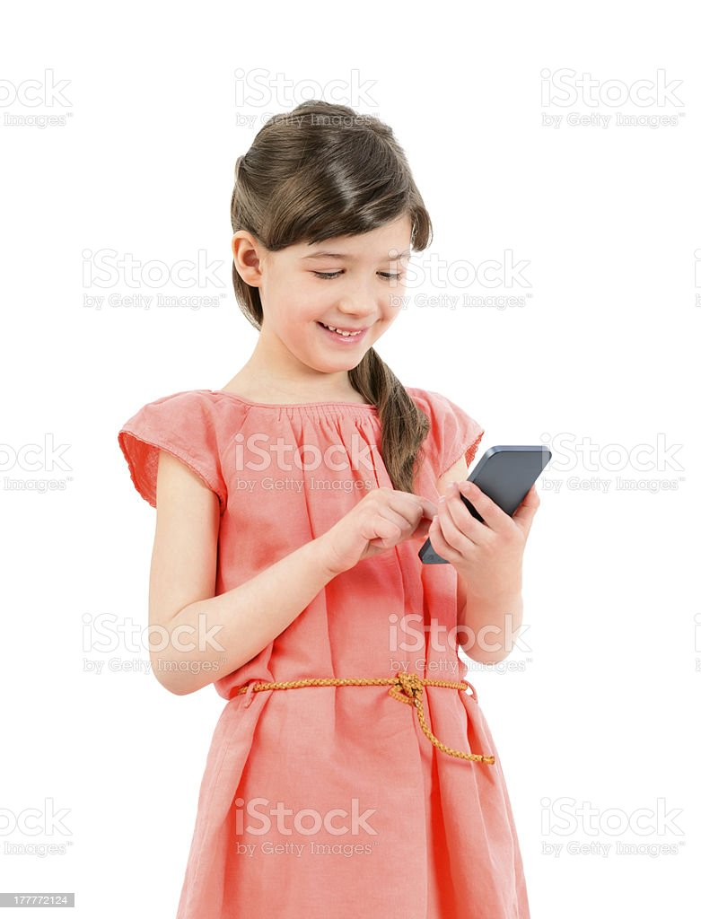 Smiling girl with mobile phone royalty-free stock photo