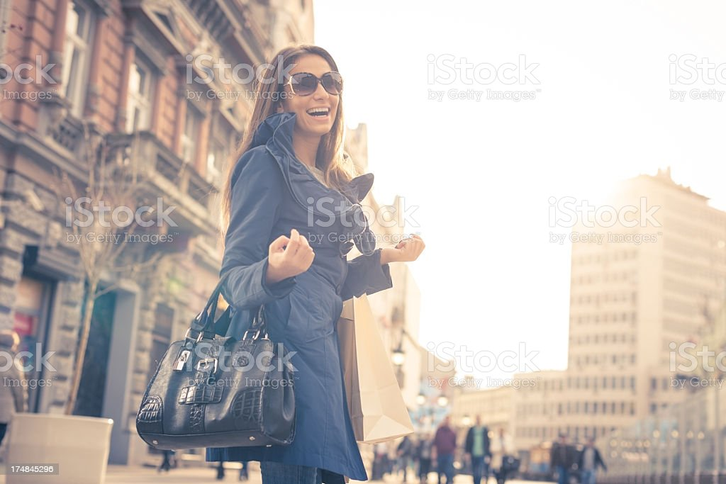 Smiling girl with shopping bags stock photo