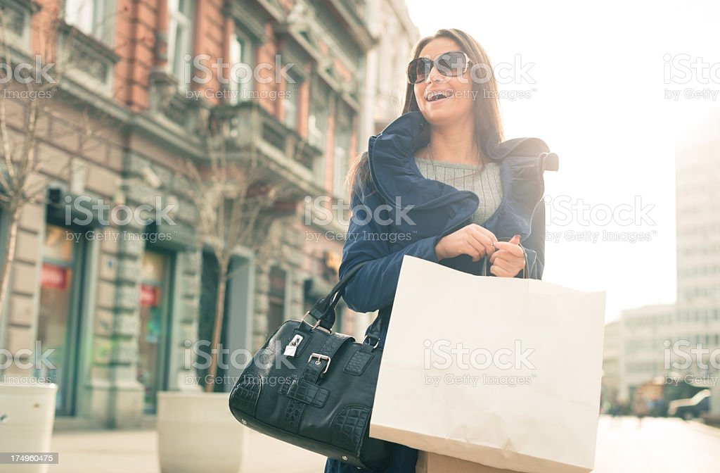 Smiling girl with shopping bags royalty-free stock photo