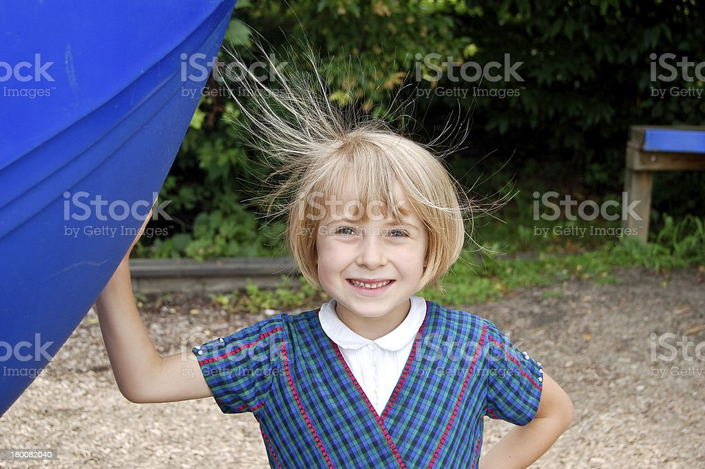 Smiling girl with static hair stock photo