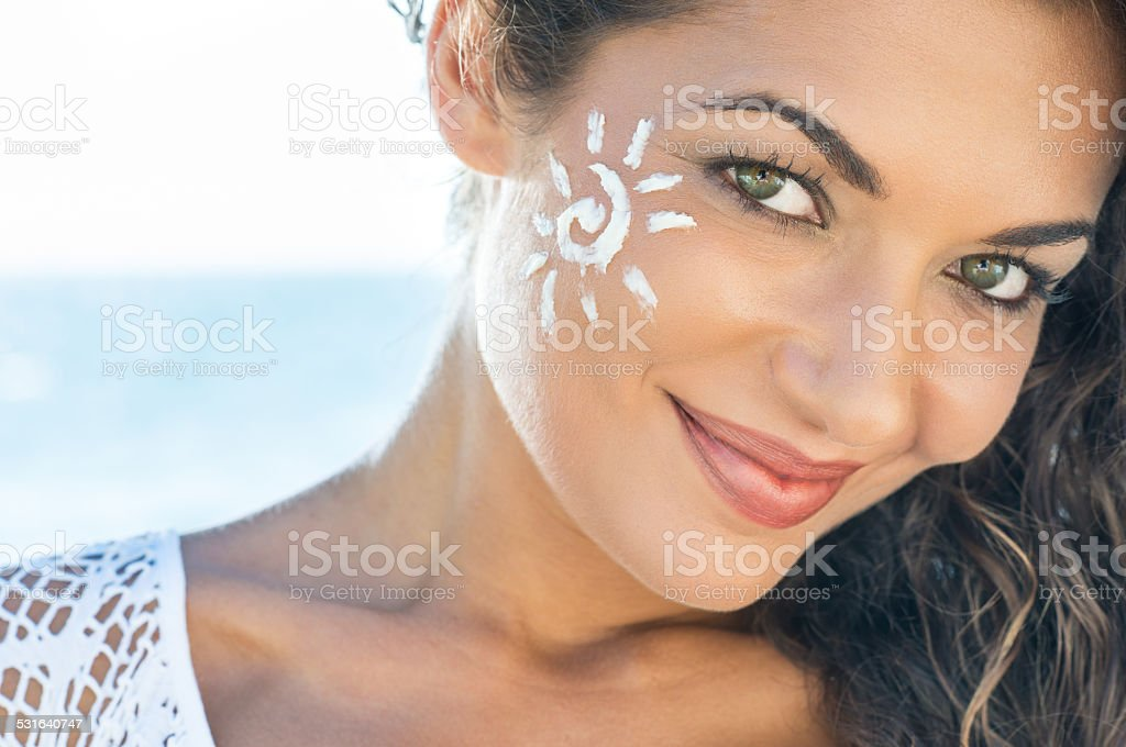 Smiling Girl With Sun Lotion stock photo