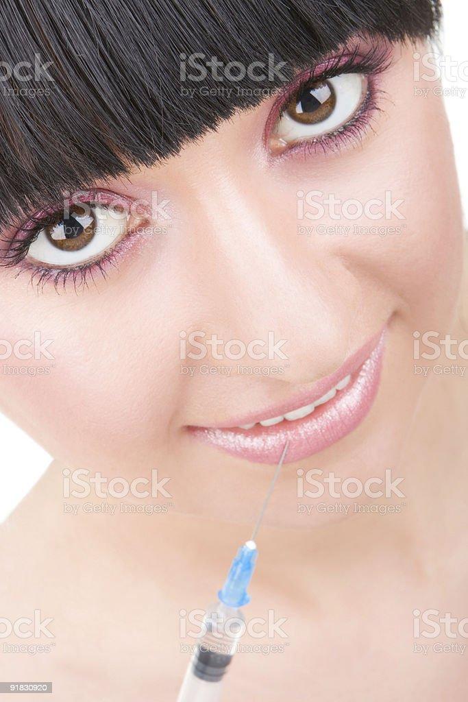 smiling girl with syringe royalty-free stock photo