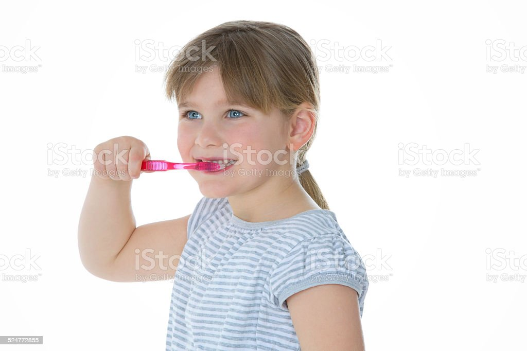 smiling girl with toothbrush stock photo
