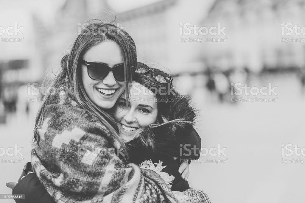 Smiling girls having fun in Paris stock photo