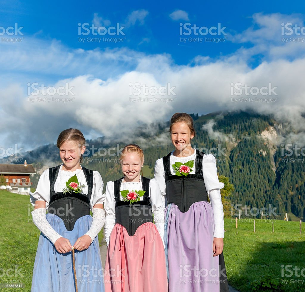 smiling girls in traditional Swiss clothing stock photo