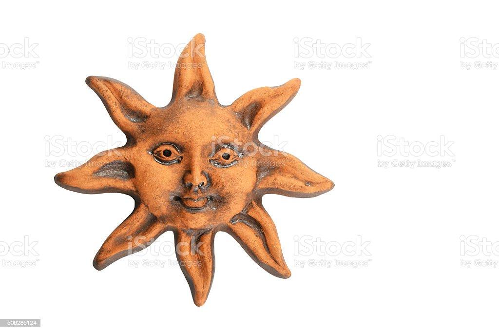 Smiling glazed ceramic sun happy face souvenir isolated on white royalty-free stock photo