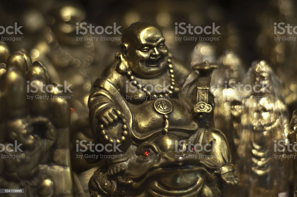Smiling golden buddha for sale stock photo