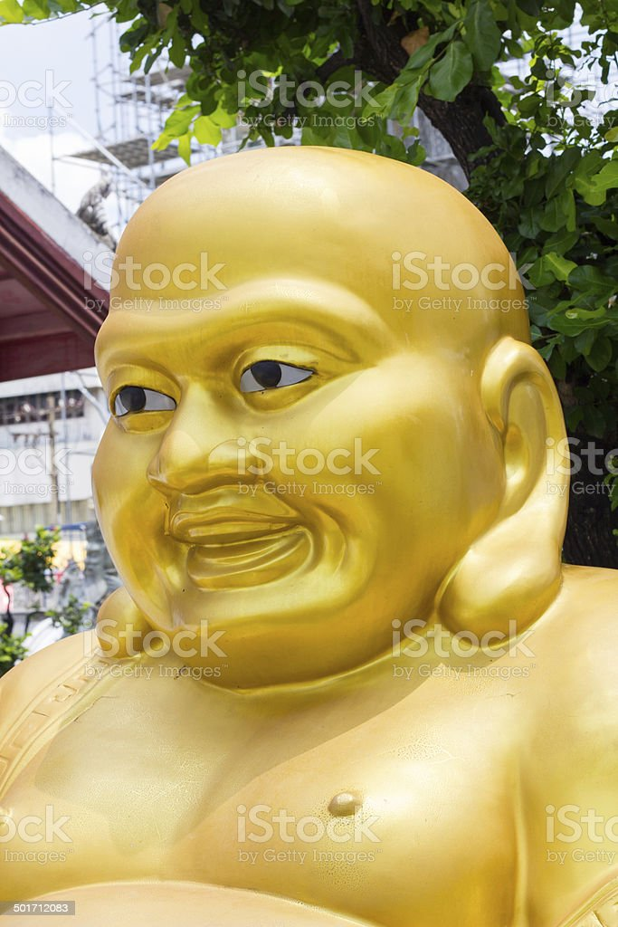 Smiling Golden Buddha Statue - chinese God of Happiness royalty-free stock photo
