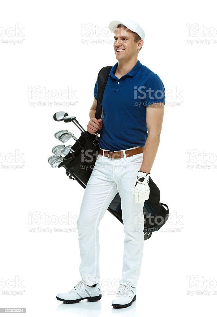 Smiling golfer holding golf bag stock photo