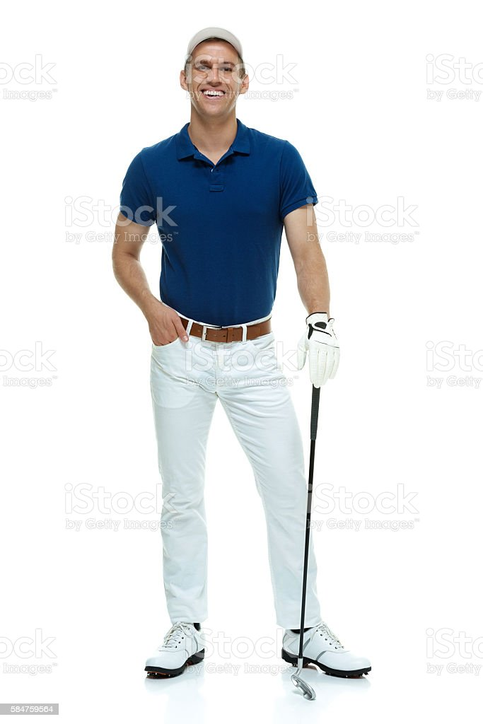 Smiling golfer standing and looking at camera stock photo