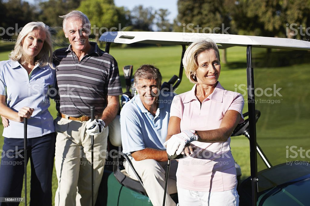 Smiling golfers royalty-free stock photo