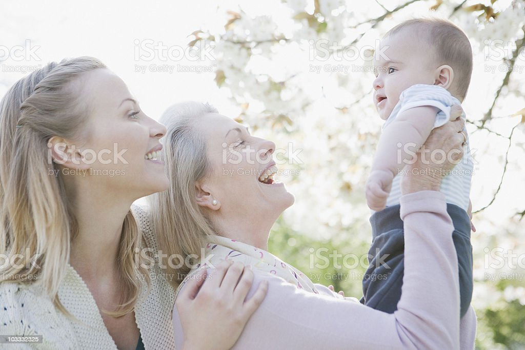 Smiling grandmother, mother and son stock photo