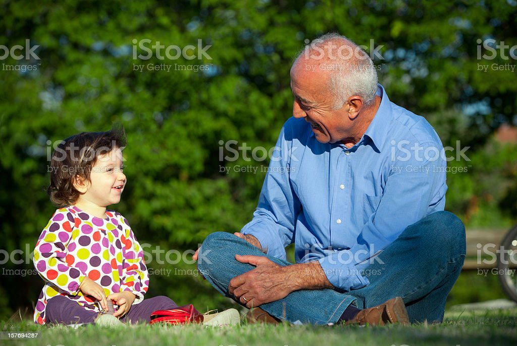 Smiling grandpa and young niece royalty-free stock photo