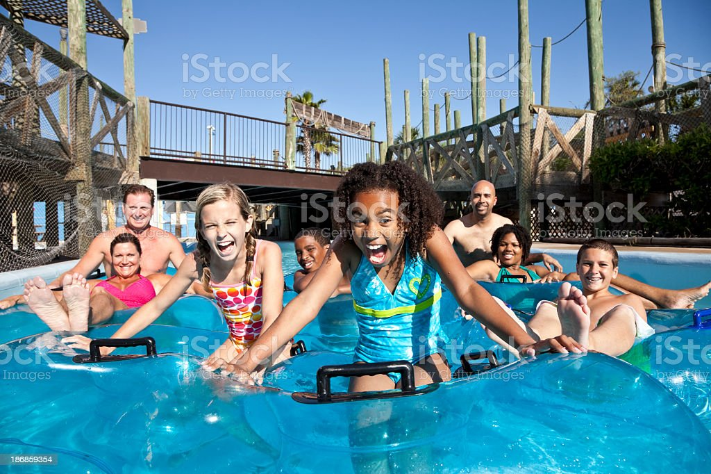 Smiling group at water park in innertubes stock photo
