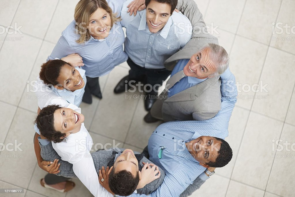 Smiling group of business people standing in a huddle royalty-free stock photo