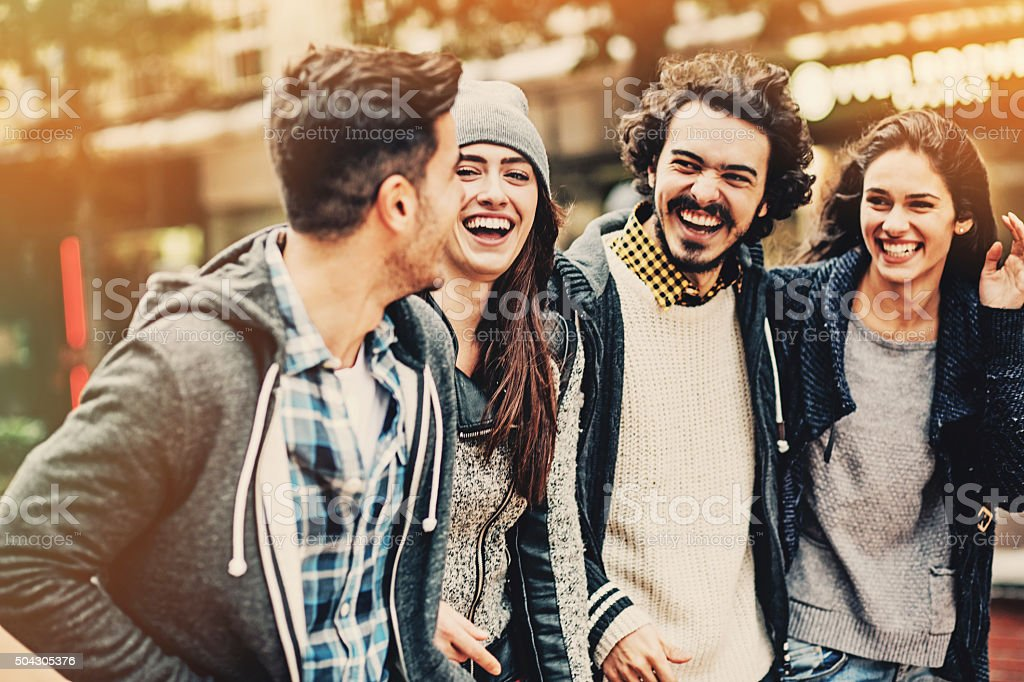 Smiling group of friends outdoors stock photo