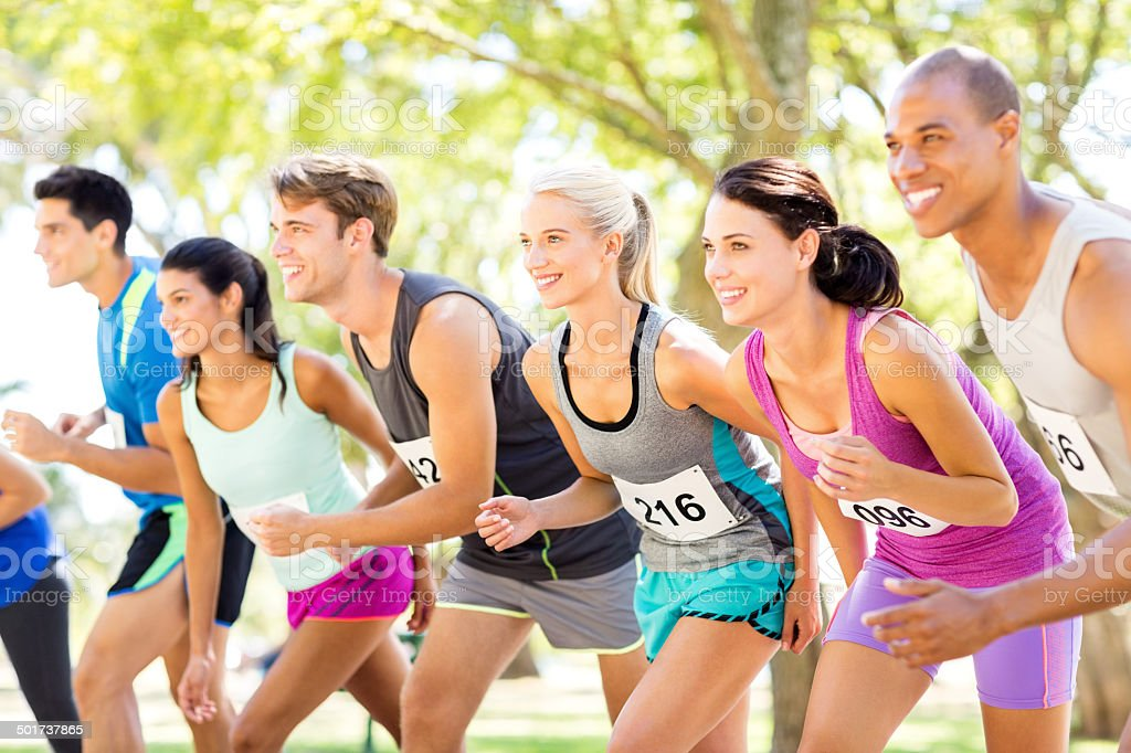 Smiling Group Of Marathon Runners At Starting Line In Park royalty-free stock photo