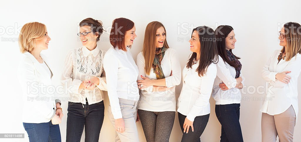 Smiling group of successful business women stock photo