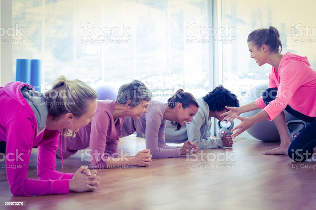 Smiling group of women exercising on floor royalty-free stock photo