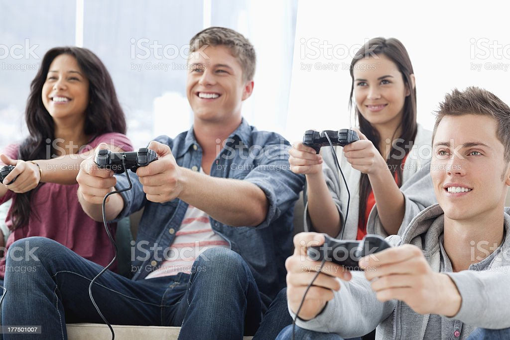 Smiling group play games with man on the ground royalty-free stock photo