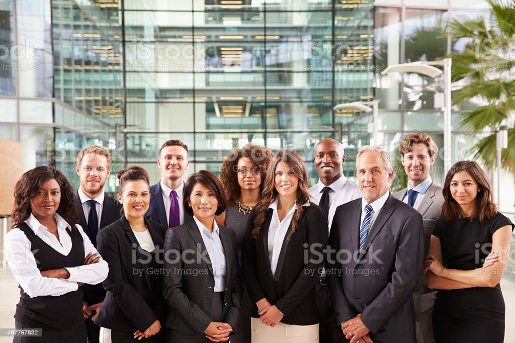 Smiling group portrait of corporate business colleagues stock photo