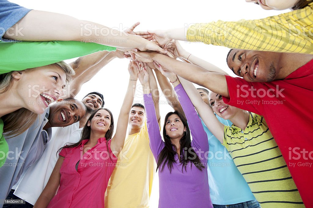 Smiling group standing in a circle. stock photo