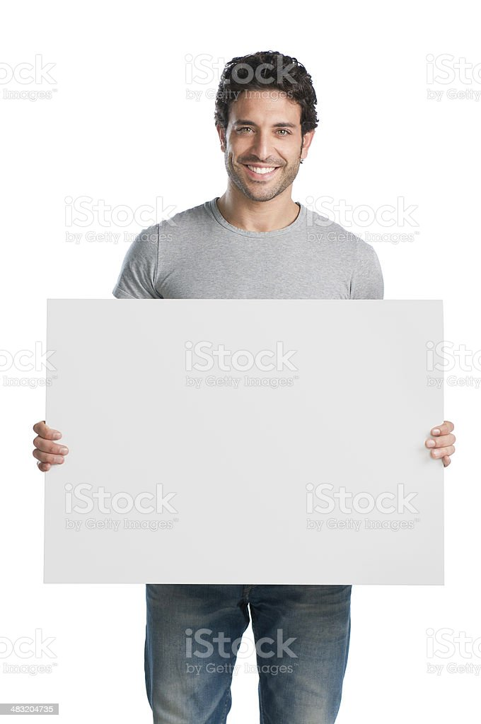 Smiling guy with blank sign stock photo