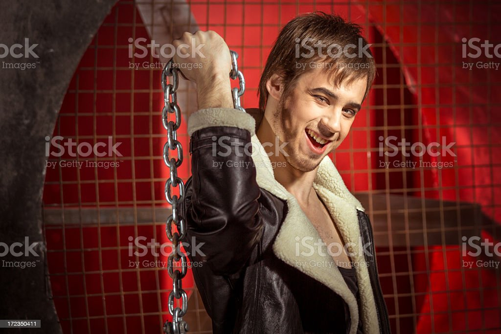 Smiling guy with metal chain stock photo
