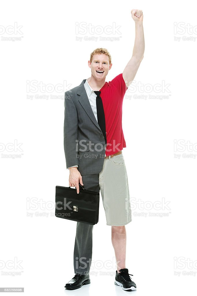 Smiling half business / casual man cheering stock photo
