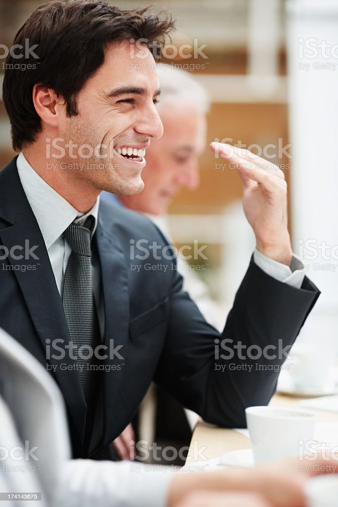 Smiling handsome business man at a board room meeting stock photo