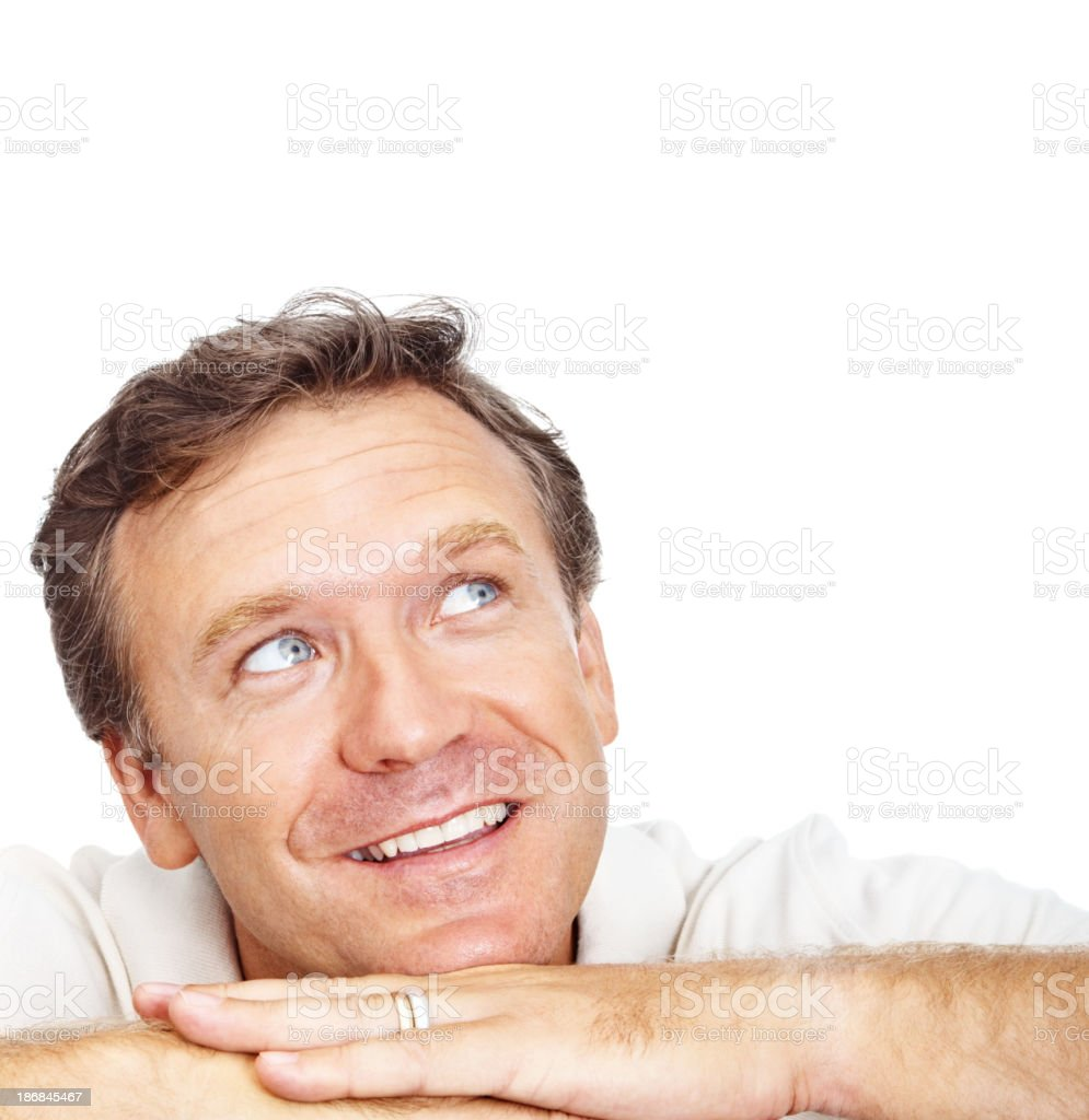 Smiling handsome guy looking up at copy space royalty-free stock photo