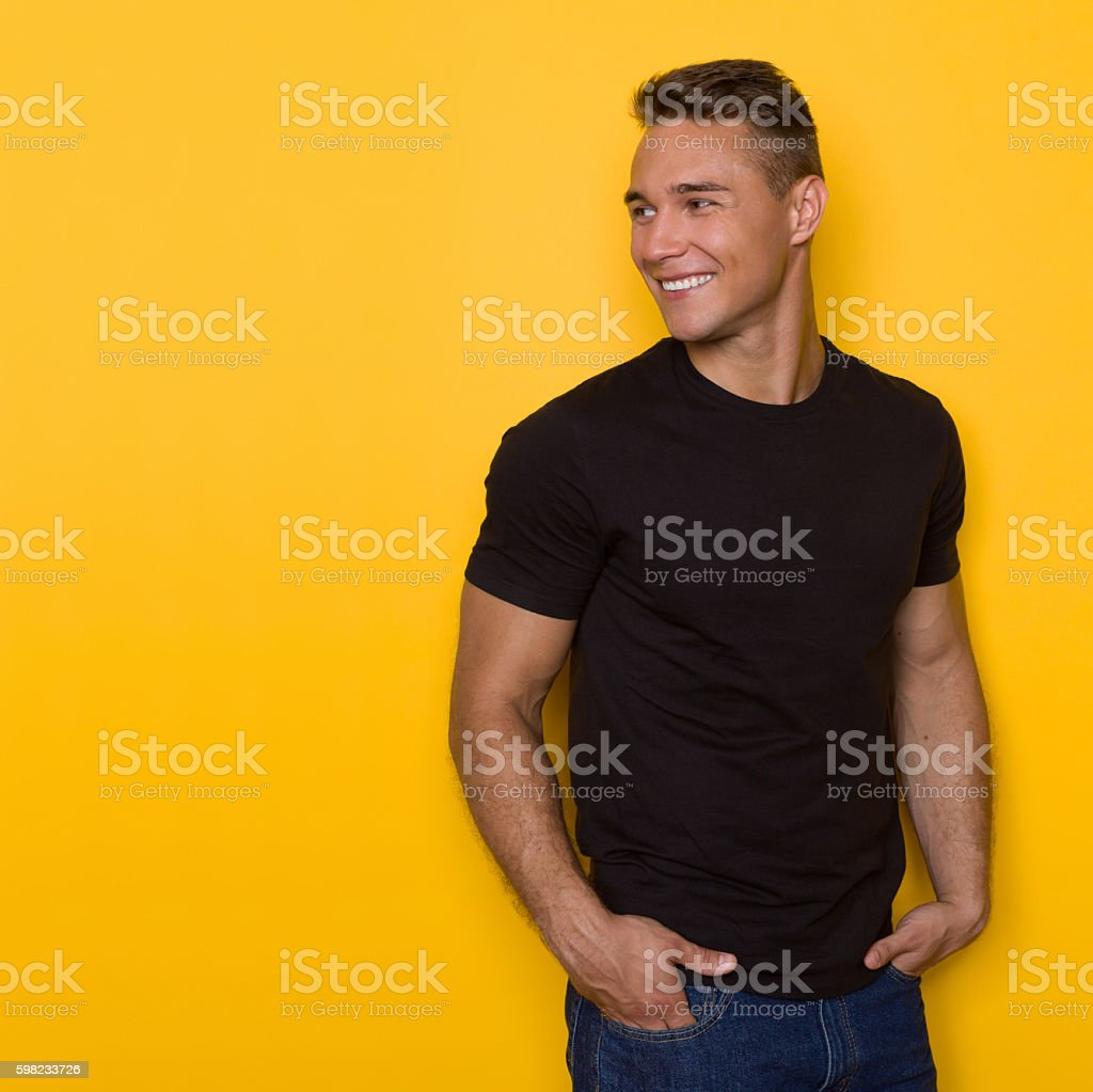Smiling Handsome Male Model Looking Away stock photo