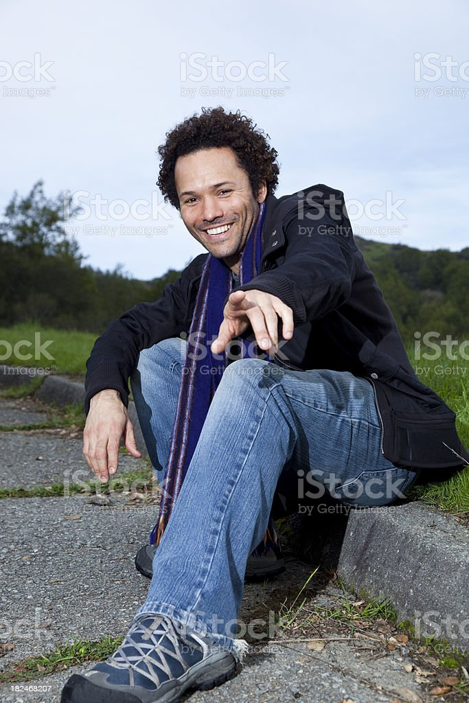 smiling handsome man gesturing to camera royalty-free stock photo