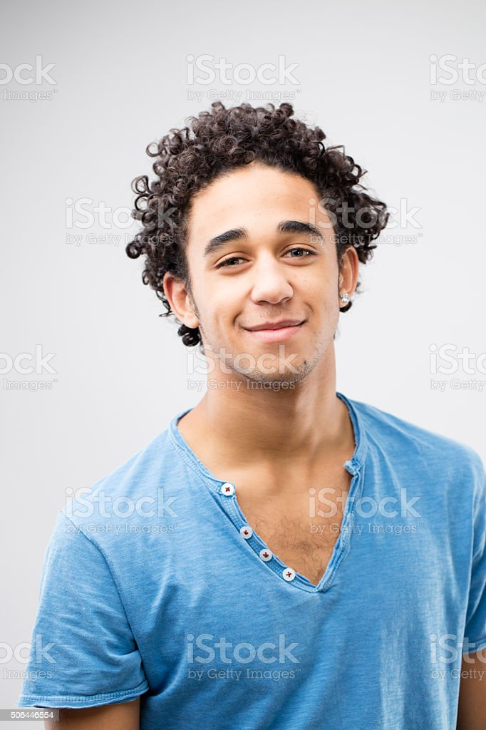 smiling handsome young man with blue t-shirt stock photo