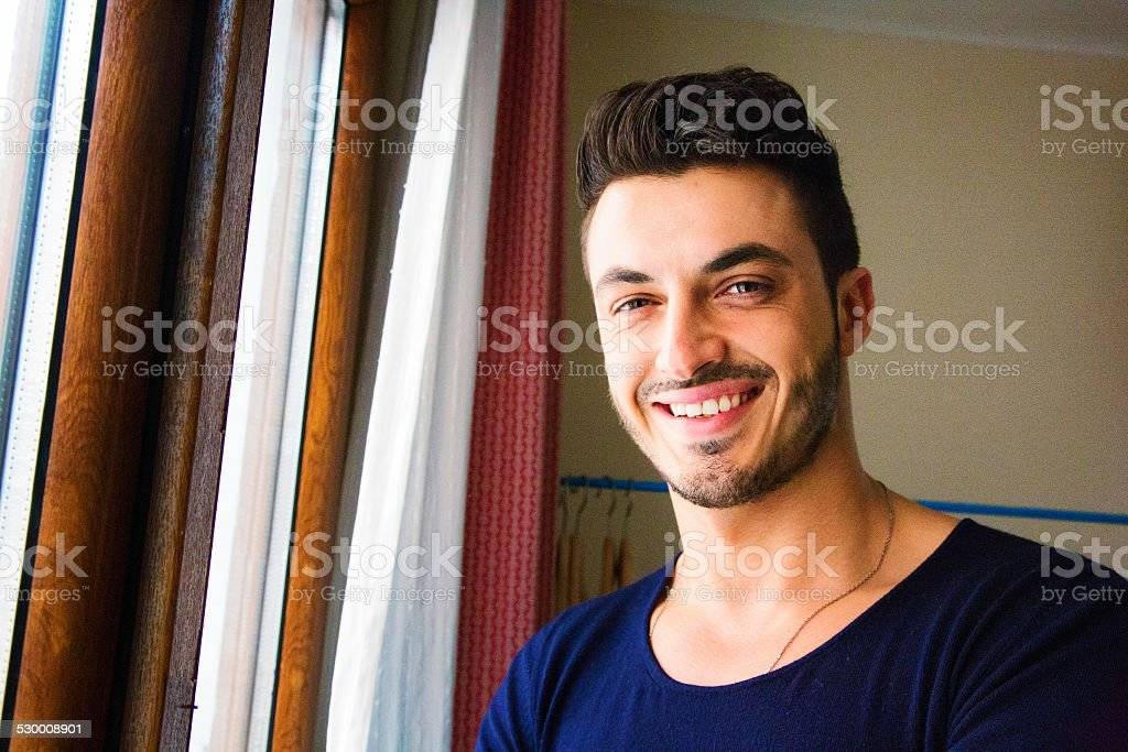 Smiling handsome young middle-eastern man portrait stock photo