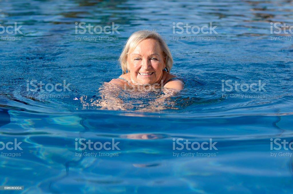 Smiling happy active elderly woman stock photo