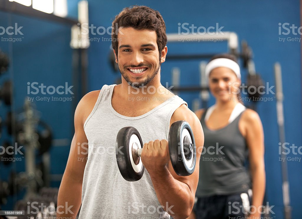 Smiling happy and young people at the fitness club. royalty-free stock photo
