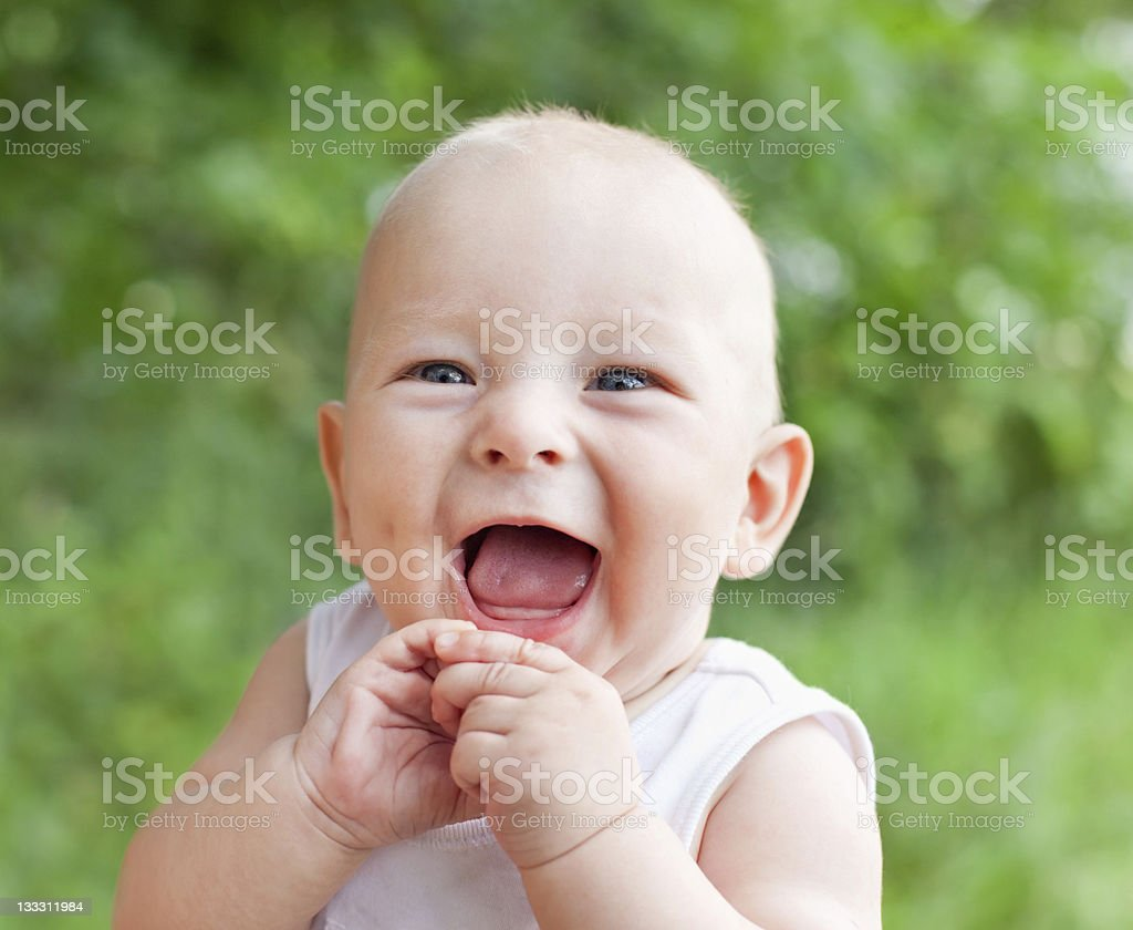 smiling happy baby boy stock photo