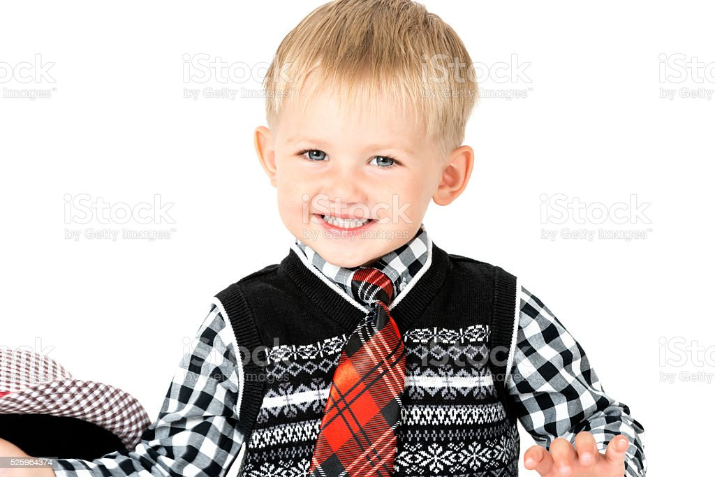 Smiling happy boy with tie studio shot isolated stock photo