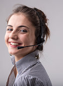 Smiling happy businesswoman wearing a headphone