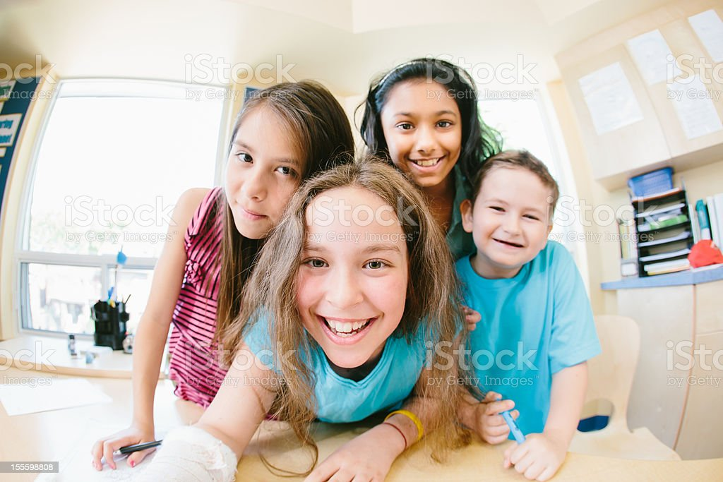 Smiling Happy Children Together in School Classroom royalty-free stock photo
