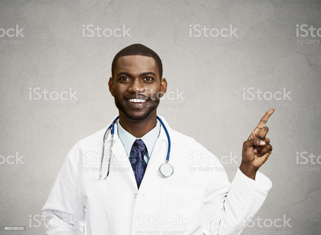 smiling, happy doctor, pharmacist, dentist pointing with finger stock photo