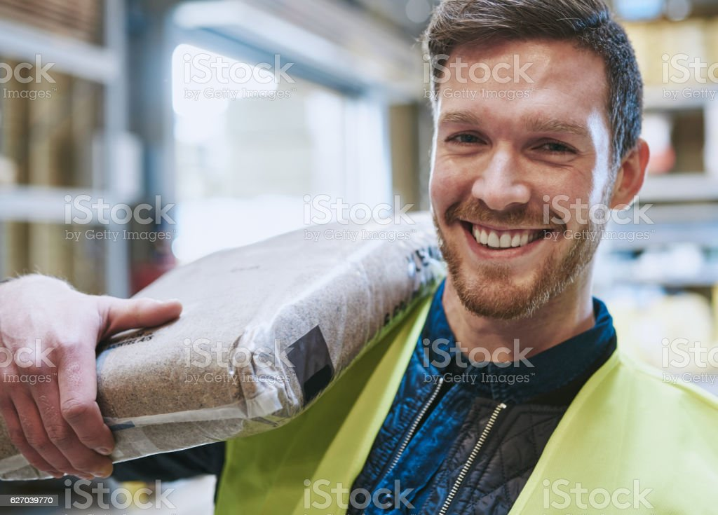 Smiling happy handsome young handyman stock photo