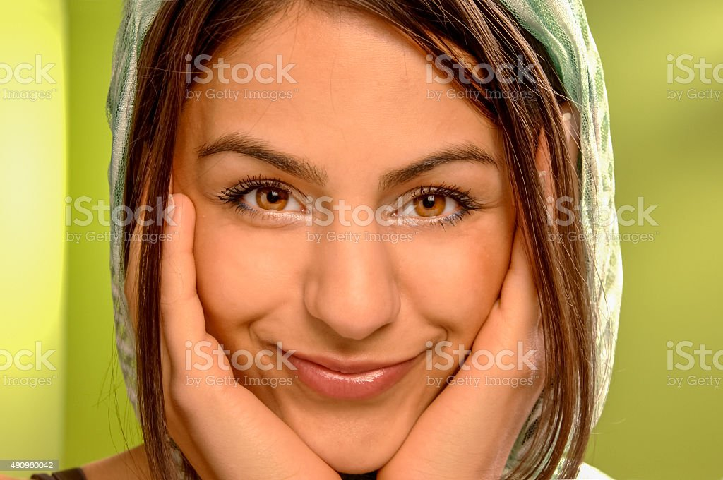 smiling happy looking young woman in veil stock photo